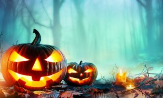 pumpkins-burning-in-a-spooky-forest-at-night-halloween-background-picture-id840261808